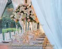 Getting married on Lake Como, wedding reception at beautiful Villa Giuseppina. Important arrangements on tall glass case and crystal candelabras. Picture by Gabriele Basilico. Event by ForeverAmoreWeddings ©