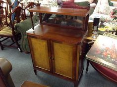 Mahogany Cabinet - Mahogany cabinet with shelf and mirror.  I think this would make an excellent compact bar.  Lots of potential uses.  Item 884-1.   Price $200.00    - http://takeitorleaveit.co/2015/06/30/mahogany-cabinet-2/