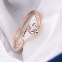 Style up your look with this round-cut Marropino morganite ring. Complemented perfectly in a setting of rose gold over sterling silver, the piece will win you appreciative glances wherever you go. Morganite Jewelry, Morganite Ring, Sterling Silver Rings, Wedding Rings, Rose Gold, Engagement Rings, Style, Enagement Rings, Swag