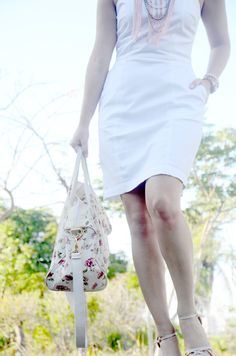 white dress, flower bag and pink maxi necklace
