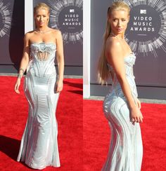 Talk about fancy! Iggy Azalea dazzled in a shimmery Versace gown. But while she went glam, she still stayed sexy, with a front cutout and booty-hugging back.  We're a little torn on her slicked back hair though. What do you think?