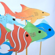 Fish, seahorse and shark puppets in many colors