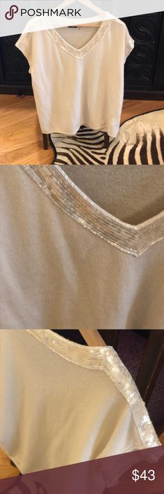 Beautiful Cashmere Magaschoni Sweater Beautiful Cashmere with sequin trim cream sweater.  Excellent condition, as I have worn it once.  It is a medium; however, fits more like a large. Magaschoni Sweaters
