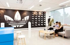Adidas' new Auckland head office combines form and function, and celebrates their strong relationship with New Zealand sport. Our creative office design is highly flexible, accommodating a variety of needs, from product displays to fashion shows. Like Adidas' products, the modern workspace allows the team to perform their best. Personality was infused throughout the space with the trademark thre