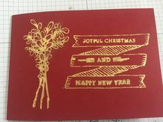 A6 landscape card made using stampin' ups cherry cobbler cardstock, Christmas banners stamp set and tonic nuvo gilding flakes.
