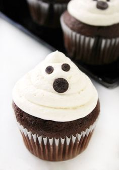 These Ghost Cupcakes with Marshmallow Buttercream Frosting may look spooky but each bite is as sweet as can be! Serve up this easy dessert recipe on your Halloween table for a kid-friendly treat that is sure to be a hit.