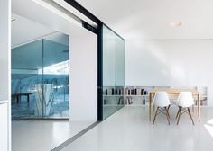 To introduce more natural light into this previously gloomy interior, the glass doors connecting the living room with the balcony were extended and the wall between the living room and the attic space was removed.