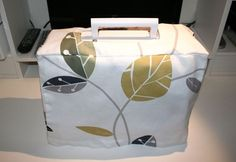 sewing machine cover - sew different coloured strip (vertical or horizontal) and add side pockets for storage