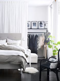 What a great idea: don't have a closet (or closet that's big enough)?  Hang a curtain between two of the bedroom walls and install curtain rods or get industrial clothing racks and set up your own closet in the partitioned space.  Plus the fabric wall adds interest to the rest of the room!