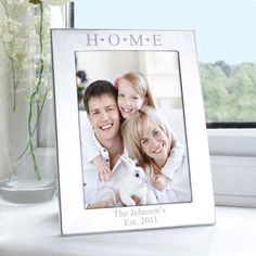 Personalise this silver 5x7 Home Hearts photo frame with any message over 2 lines at the bottom of the frame up to 30 characters each H O M E is