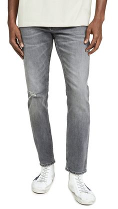 CALVIN KLEIN JEANS SLIM FIT JEANS IN EARP GREY. #calvinkleinjeans #cloth