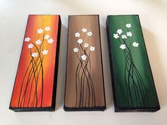 These paintings are made to order...they are each 4x12x1.5.  You get a set of 3 for $89.99  You can chose any color you want, I have shown 6