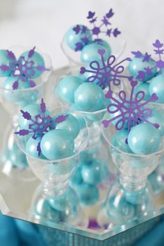 Purple snowflake cutouts make the blue shimmer gumballs look absolutely fantastic! Styled by Brittany Schwaigert #BirthdayExpress #Frozen