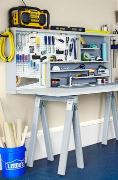 This foldable tool storage unit provides workspace yet takes up little room. Bifold doors drop down to form a work surface, and sawhorses serve as legs. -- Lowe's Creative Ideas
