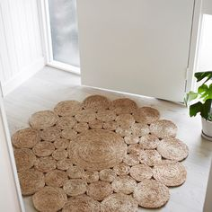 Camellia Hemp Round Rug in Entry