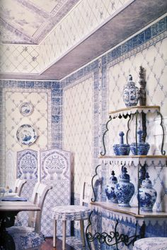 Mark Hampton's blue and white dining room with Portuguese tiles on walls and painted look-alike on cornice and ceiling (Watercolor by Robert Jackson)