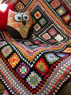 A lovely crocheted mixed Granny Square afghan (and cute owl cushion too) from Fiddlesticks
