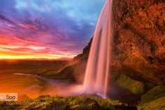 Divine Light - Pinned by Mak Khalaf The light at sunset was glorious Seljalandsfoss waterfall. South coast of Iceland. Photography Tours and Workshops in Iceland My webpage Workshop Facebook Page My Photography Facebook Page Landscapes Seljalandsfosscloudsicelandicelandic photographerlong exposuresnorri gunnarssonsunsunsettravelwaterwaterfall by snorri