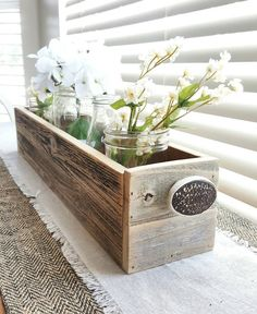 This Decorative Box is made with reclaimed Barnwood giving you that perfect cottage country feel. Use on your dining table as the main center piece, your coffee table for decor, or even at a wedding to hold guest favors! This piece is so versitile! Dimensions are 24 Long x 4.5 Deep x 4.5 Tall