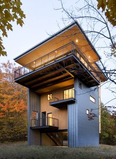 Raising the primary living space above the dense surrounding woods and using spacious deck overhangs, the Tower House gains light, air and views of Glen Lake and Lake Michigan beyond. By Balance Associates.