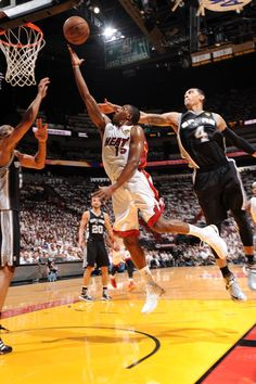 Mario Chalmers lays it up on Danny Green during Game Two of the 2013 NBA Finals