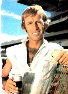 Paul Hogan, when he was just Alligator Dundee, holding a glass of some unknown Australian beer. Linda Kozlowski, The First Wives Club, Australian Beer, Dundee, New Face, New Zealand, Patrick Swayze, Actors, Postage Stamps