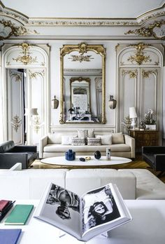 beautiful home of Plume Voyage magazine editor Capucine Gougenheim-Geagea. The Haussmann apartment in Paris was featured in Cote Maison and has gorgeous gilt boiseries and and an enviable art collection.