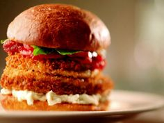 Deconstructed Eggplant Parmesan Sandwich from FoodNetwork.com - breaded and fried eggplant with burrata cheese, pickled cherry peppers and fresh basil on a brioche bun
