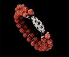 Bracelet Corail, platine, or, diamants, onyx, émail noir . 1930 - Cartier
