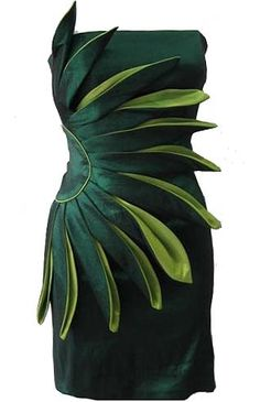 Floral Architect Dress: Features butter-soft satin fabric saturated in a deep forest-green hue, captivating half-flower based at the right side of the dress, wild origami-style petals highlighted with a vivid lime contrast spanning the front, and a solid backside to finish.