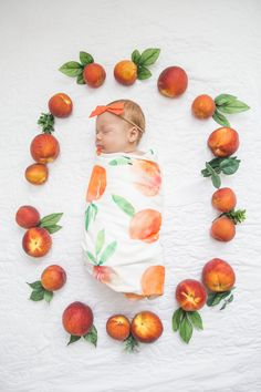Sweet as can be. An organic swaddle blanket goes double duty for birth announcements and everyday use.