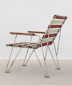 Anonymous; Lacquered Wood and Enameled Metal Armchair, 1950s.