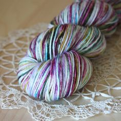 """Hand dyed magic:  """"calypso"""" from Phydeaux Designs & Fiber.  Plums, teals, golds, kelp greens, juicy berries.  Dyed on order on any of Phydeaux's base yarns.  See more by clicking through the photo!  :)"""