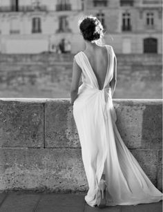 a beautiful floor length, flowy white gown. love the plunging back and elegant bun.