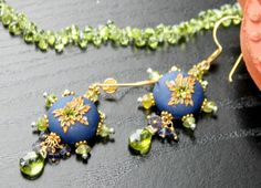 Peridot and Iolite earrings with Clay floral by Peelirohini, $57.00