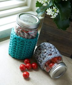 """""""My idea for this Mason Jar Cozy began with a desire to crochet something that would look cute during the day and, with the addition of a tea light, would cast a beautiful patterned shadow around it at night for those summer campfire evenings."""