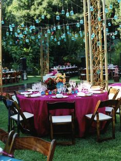 Round tables for the guests, with couple up front near the porch.  Love the hanging led laterns in blue, so different than just traditional lights, very festive!  #bridalshower #polkadotdesign