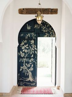 gold floral stenciling on black doors / sfgirlbybay