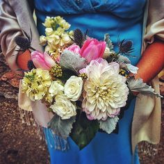 Bridesmaid bouquet for a wedding at Sapphire Point. All the girls were dressed in different colored dresses too.  Photo by Stacy Sanchez  petalandbean.com breckweddings.com