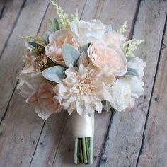 Cool and creamy peaches, ivories, and greens - the perfect silk bouquet for a spring wedding! By Kate Said Yes Weddings