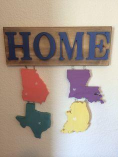 Home sign w cutout states. Texas Georgia and Louisiana