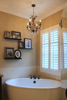 This beautiful master bathroom features a free-standing Kohler- @kohlerco  bathtub with oil rubbed bronze fixtures and chandelier! All this and more from Adalay Interiors in Tampa Bay! www.adalay.com