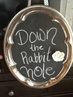 Alice in Wonderland tea party down the rabbit hole sign