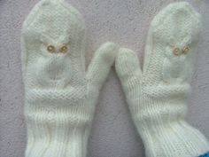 Handknit in a lovely soft aran wool these little owl mittens are soft and warm. They have been lightly felted to add extra thickness.    Handknit in t