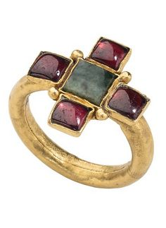 Early Christian Gemstone Ring Date: 4th–5th century Culture: Roman Medium: Gold, garnets, and emerald Dimensions: Bezel 3 x 17 x 18 mm.; circumference 55 mm.; weight 4.2 gr.