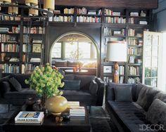 masculine library full of rich woods, velvet sofas and iron chandelier. love it.