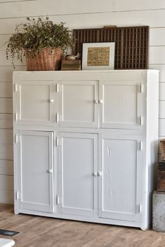 White Farmhouse Cabinet Makeover    Find something like this to house stuff in the dining room
