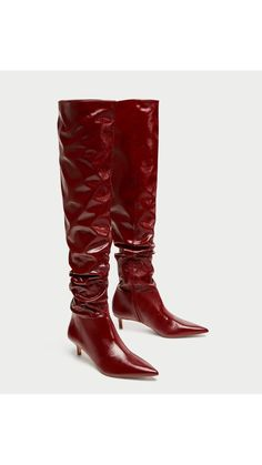 Red patent leather high boots