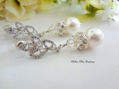 Swarovski White Pearl and Crystal Bridal Earrings by DebraAnnCreations.etsy.com #bridal #wedding #bridaljewelry #weddingjewelry #bridalearrings #weddingearrings #formaljewelry #earrings #pearlearrings #pearljewelry #swarovski