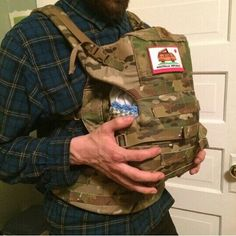 Tactical baby carrier. I need this for the coming little one! . . with a matching backpack for the big one!